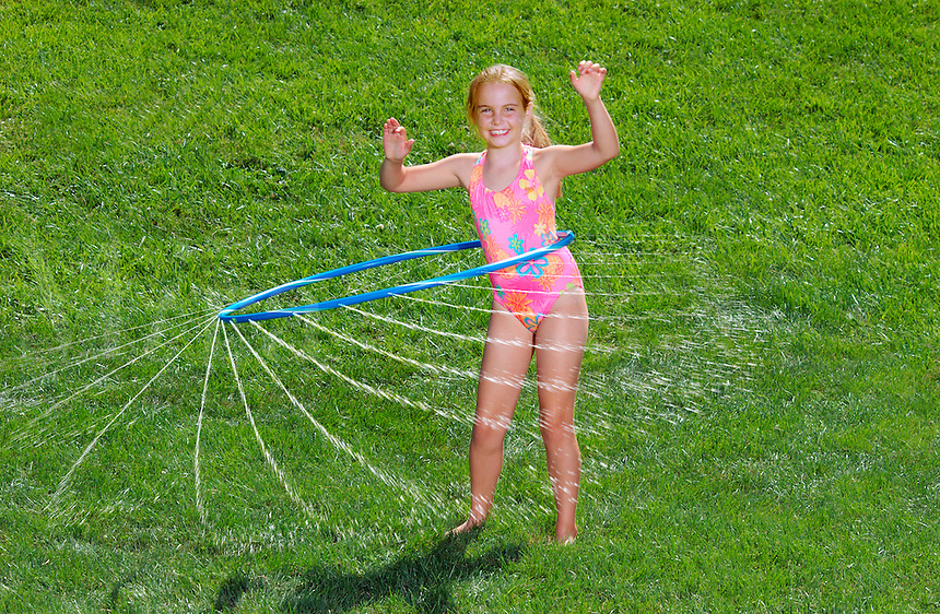 Girl with water hoolahoop.