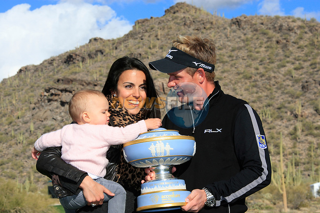 Diane and Elle, Luke Donald's wife and baby daughter on the 16th green after Luke wins the tournament on the Finals Day 5 of the Accenture Match Play Championship from The Ritz-Carlton Golf Club, Dove Mountain, Sunday 27th February 2011. (Photo Eoin Clarke/golffile.ie)
