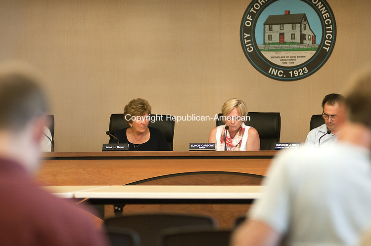 TORRINGTON, CT, 06  JULY 15 - Mayor Elinor C. Carbone, right, and Councilwoman Anne L. Ruwet discuss auditing the finances of the Torrington Board of Education at a City Council meeting Monday.  Alec Johnson/ Republican-American