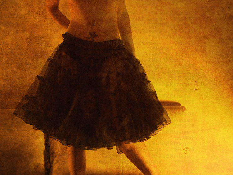 a young woman with a black crinoline in a yellow room