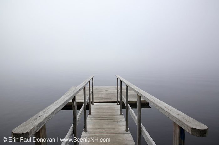 A dock on the Connecticut River in foggy conditions in Waterford, Vermont USA.