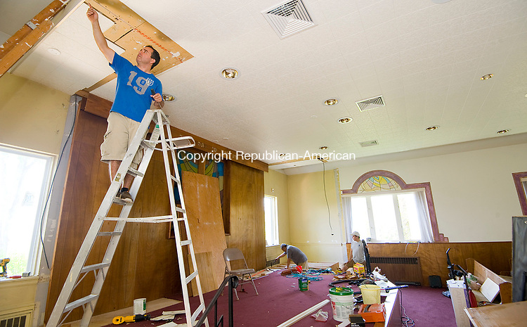 TORRINGTON, CT-071817JS02--Richard Lopez, Pastor of the Iglesia Pentecostal Unida Latinoamericana church, works on renovations to the former Beth El Synagogue in Torrington. The church recently purchased the building and is expected to hold its first service on August 5, but could hols a service this Sunday if the renovations are completed. Jim Shannon Republican-American