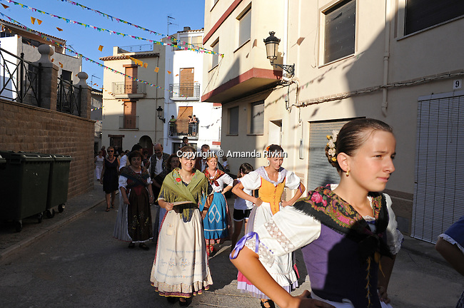Young women parade in traditional Valencian attire during the municipal fiestas in Costur, Spain on August 15, 2009.