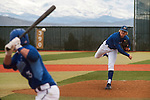 Western Nevada Wildcats' Conor Harber (11) throws a pitch in the first inning against  the Salt Lake Community College Bruins at WNC in Carson City, Nev., on Sunday, March 2, 2014. The Bruins won game 1 of a double-header against the Wildcats in overtime 9-4.<br /> (Photo by Kevin Clifford)