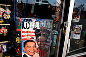 Chicago, Illinois.November 4, 2008.USA..On election day in the United States residents shows off his Barack Obama goods in his shop on Chicago's South-side.