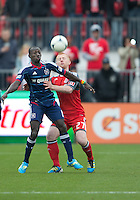 21 April 2012: Chicago Fire forward Dominic Oduro #8 and Toronto FC defender Richard Eckersley #27 in action during a game between the Chicago Fire and Toronto FC at BMO Field in Toronto..The Chicago Fire won 3-2....