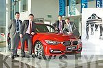 Pat Ahern, Paul Ahern, Padraig Brick and Gordon Lunn Sales manager with the new BMW 320d Sport which was launched in Ahern's BMW garage Castleisland on Saturday..