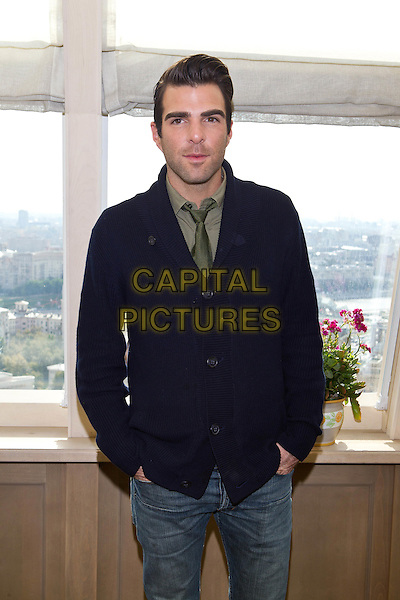 """Zachary Quinto.At the premiere of """"Margin Call"""",.Moscow, Russia, 27th September 2011..half length  green shirt tie blue cardigan  jeans hands in pockets .CAP/PER/SB.©SB/PersonaStars/Capital Pictures."""