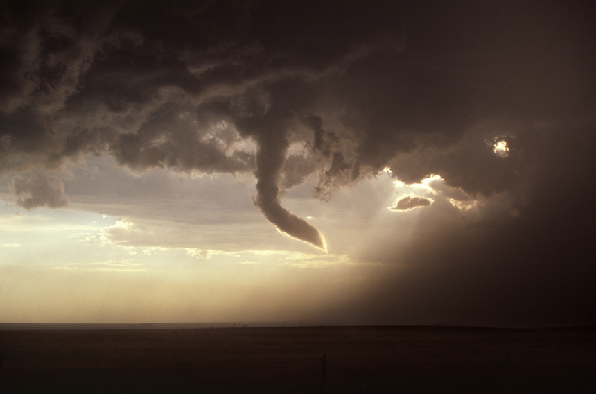 A silvery-tipped funnel cloud dangles from the base of a supercell thunderstorm near Morse Texas in late June.