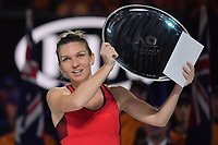 January 27, 2018: Number one seed Simona Halep of Romania receives the runners up trophy in the Women's Final after losing to number two seed Caroline Wozniacki of Denmark on day thirteen of the 2018 Australian Open Grand Slam tennis tournament in Melbourne, Australia. Photo Sydney Low