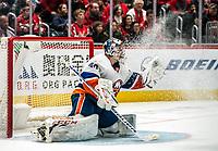 WASHINGTON, DC - JANUARY 31: Semyon Varlamov #40 of the New York Islanders  makes an ice storm save during a game between New York Islanders and Washington Capitals at Capital One Arena on January 31, 2020 in Washington, DC.