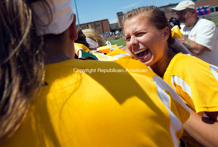 West Haven, CT- 13 June 2015-061315CM18-   The Holy Cross girls softball team celebrates, including Becca Anderson, right, following a 4-0 win over Thomaston to capture the Class S state softball title in West Haven on Saturday.  Christopher Massa Republican-American