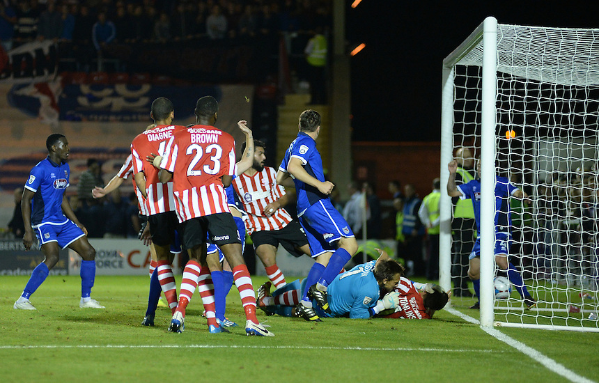 Lincoln City&rsquo;s Hamza Bencherif scores his sides third goal <br /> <br /> Photo by Chris Vaughan/CameraSport<br /> <br /> Football - English Football Vanarama Conference Premier League - Lincoln City v Grimsby Town - Tuesdayb9th September 2014 - Sincil Bank - Lincoln<br /> <br /> &copy; CameraSport - 43 Linden Ave. Countesthorpe. Leicester. England. LE8 5PG - Tel: +44 (0) 116 277 4147 - admin@camerasport.com - www.camerasport.com