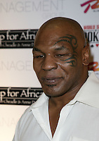 MIKE TYSON .The Ante Up for Africa Celebrity Poker Tournament at the Rio Resort Hotel and Casino, Las Vegas, Nevada, USA..July 2nd, 2009.headshot portrait white shirt tattoo .CAP/ADM/MJT.© MJT/AdMedia/Capital Pictures