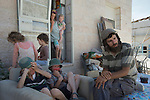 Eliashiv, a Jewish rabbi at Od Yosef Chai yeshiva, with his kids in backyard of their newly-built house, in the Israeli settlement of Yitzhar, West Bank.