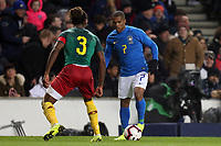 Gaetan Bong of Cameroon and Brighton & Hove Albion and Douglas Costa of Brazil and Juventus during Brazil vs Cameroon, International Friendly Match Football at stadium:mk on 20th November 2018