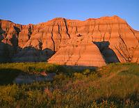 SDBD_006 - USA, South Dakota, Badlands National Park, Sunset light defines bands in eroded, sedimentary layers, North Unit.