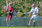 Los Angeles, CA 03/16/10 - Kevin Law (Chico State # 1) and Will Shaffer (LMU # 23) in action during the Chico State-Loyola Marymount University MCLA interdivisional game at Leavey Field (LMU).  LMU defeated Chico State 7-4.