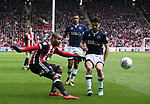 Leon Clarke of Sheffield Utd crosses the ball during the championship match at the Bramall Lane Stadium, Sheffield. Picture date 14th April 2018. Picture credit should read: Simon Bellis/Sportimage