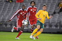 MELBOURNE, AUSTRALIA - OCTOBER 14: Harry Kewell from Australia crosses the ball in a AFC Asian Cup 2011 match between Australia and Oman at Etihad Stadium on October 14, 2009 in Melbourne, Australia. Photo Sydney Low www.syd-low.com