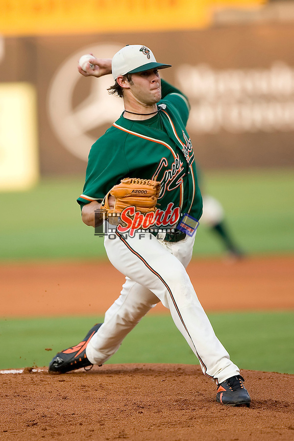Greensboro Grasshoppers starting pitcher Aaron Thompson winds up to deliver the ball to the plate versus the West Virginia Power at First Horizon Park in Greensboro, NC, Wednesday, August 23, 2006.