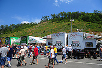 Jun. 17, 2011; Bristol, TN, USA: Fans surround the pit of NHRA funny car driver John Force during qualifying for the Thunder Valley Nationals at Bristol Dragway. Mandatory Credit: Mark J. Rebilas-
