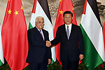 Palestinian President Mahmoud Abbas, shakes hands Chinese President Xi Jinping, during a signing ceremony at the Great Hall of the People in Beijing, China, on July 18, 2017. Abbas is on an official visit to China from July 17-20. Photo by Thaer Ganaim