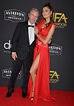 John Savage, Blanca Blanco  arrives at the 23rd Annual Hollywood Film Awards at The Beverly Hilton Hotel on November 03, 2019 in Beverly Hills, California