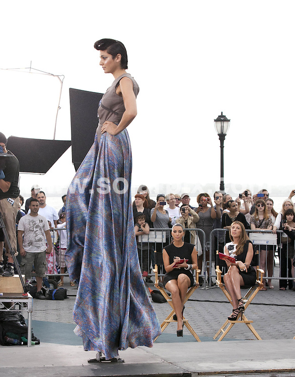 "**ALL ROUND PICTURES FROM SOLARPIX.COM**                                             **SYNDICATION RIGHTS FOR UK, AUSTRALIA, DENMARK, PORTUGAL, S. AFRICA, SPAIN & DUBAI (U.A.E) & ASIA (EXCLUDING JAPAN) ONLY**                                                                                  Caption:  Kim Kardashian, Nina Garcia, Michael Kors, Heidi Klum - ""Project Runway"" Filming at Battery Park in New York City on June 24, 2011 - Battery Park - New York City, NY, USA                                                                             This pic: Models & Judges                                                                                             JOB REF: 13614       PHZ       DATE: 24.06.2011                                                           **MUST CREDIT SOLARPIX.COM OR DOUBLE FEE WILL BE CHARGED**                                                                      **MUST AGREE FEE BEFORE ONLINE USAGE**                               **CALL US ON: +34 952 811 768 or LOW RATE FROM UK 0844 617 7637**"
