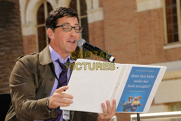 Dan Bucatinsky.18th Annual Los Angeles Times Festival of Books held at USC, Hollywood, California,USA, .20th April 2013..half length glasses reading book holding microphone shirt tie 'Does this baby make me look straight?'.CAP/ADM/BP.©Byron Purvis/AdMedia/Capital Pictures