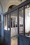 Historic interior of Inglesham church, Wiltshire, England. The building is under the care of the Churches Conservation Trust. Much of the current fabric of the church is 13th century, its origins are older dating back to Anglo- Saxon. A planned Victorian major restoration project in the 1880s was resisted by William Morris. Morris ensured that the church kept its original medieval identity. The box pews are the original from the 17th and 18th century. Layers of paintings from early medieval  onwards cover the walls, in places seven layers thick. It is a building of national significance.