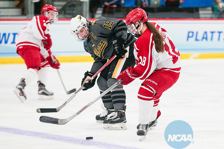 ADRIAN, MI - MARCH 18: Kaylyn Schroka (19) of Adrian College defends Courtney Moriarty (18) of Plattsburgh State University during the Division III Women's Ice Hockey Championship held at Arrington Ice Arena on March 19, 2017 in Adrian, Michigan. Plattsburgh State defeated Adrian 4-3 in overtime to repeat as national champions for the fourth consecutive year. by Tony Ding/NCAA Photos via Getty Images)