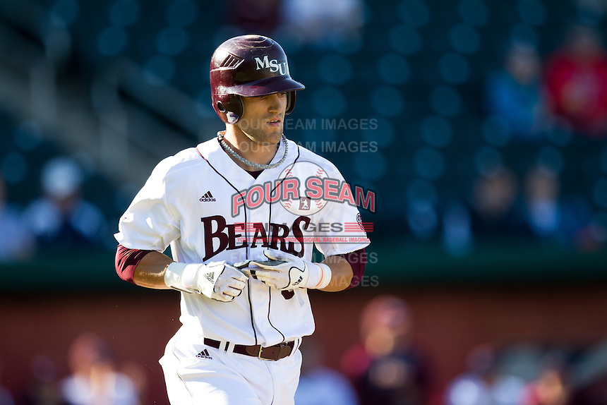Spiker Helms (9) of the Missouri State Bears heads to first base after being walked during a game against the Southern Illinois University- Edwardsville Cougars at Hammons Field on March 9, 2012 in Springfield, Missouri. (David Welker / Four Seam Images)