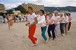 Young at Heart. British seniors on winter holiday in Balearic Islands Palma Nova Majorca Spain. Holiday rep leads the daily fun exercise class