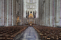 The nave, looking towards the apse, rood screen, choir and altar, with the pulpit of gilded wood designed by Pierre-Joseph Christophle, 1715-1782, on the left, in the Basilique Cathedrale Notre-Dame d'Amiens or Cathedral Basilica of Our Lady of Amiens, built 1220-70 in Gothic style, Amiens, Picardy, France. Amiens Cathedral was listed as a UNESCO World Heritage Site in 1981. Picture by Manuel Cohen