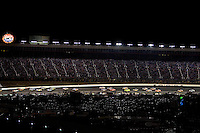 Cars make their way down the back stretch during the Bank of America 500 NASCAR race at Lowes's Motor Speedway in Concord, NC.