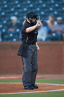Home plate umpire Jennifer Pawol indicates she needs 3 baseballs during the South Atlantic League game between the Hickory Crawdads and the Ocelotes de Greensboro at First National Bank Field on June 11, 2019 in Greensboro, North Carolina. The Crawdads defeated the Ocelotes 2-1. (Brian Westerholt/Four Seam Images)