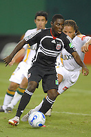 DC United midfielder Freddy Adu (9) controls the ball and is covered by Los Angeles Galaxy midfielder Cobi Jones. Los Angeles Galaxy defeated DC United 5-2, Saturday, August 26, 2006 at RFK Stadium.