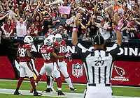 cards1011 166497 10/10/10- Arizona Cardinals celebrate Kerry Rhodes' touchdown in the fourth quarter against the New Orleans Saints Sunday.  (Pat Shannahan/ The Arizona Republic)