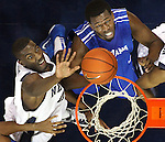 Nevada's Dario Hunt and Louisiana Tech's Olu Ashaolu fight for a rebound during Saturday's NCAA men's basketball game, Jan. 22, 2011, in Reno, Nev..Photo by Cathleen Allison
