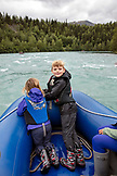 USA, Alaska, Coopers Landing, Kenai River, group of individuals rafting down the Kenai River