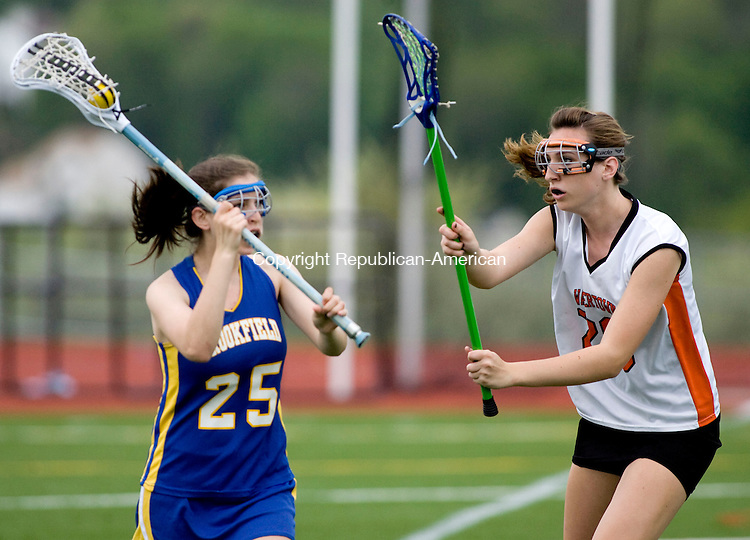 WATERTOWN, CT - 03 MAY 2010 -050310JT23-<br /> Brookfield's Abby Aaron looks for a pass while under pressure from Watertown's Jojo Shields during Monday's game at Watertown.<br /> Josalee Thrift Republican-American