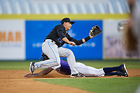 Akron RubberDucks second baseman Mark Mathias (23) waits for a throw as Champ Stuart slides in during a game against the Binghamton Rumble Ponies on May 12, 2017 at NYSEG Stadium in Binghamton, New York.  Akron defeated Binghamton 5-1.  (Mike Janes/Four Seam Images)