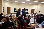 Congressman-elect Jim Bridenstine, from Oklahoma's First District, right, heads to another room after selecting office furniture in the Rayburn House Office Building in Washington, DC on Nov. 30, 2012.