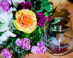 Flower arrangements from a recent wedding complement the wines being tasted at Loudoun Valley Vineyards, Waterford VA.