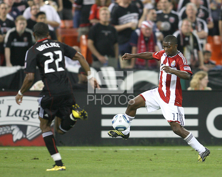 Rodney Wallace #22 of D.C. United runs towards Michael Lahoud #11 of Chivas USA during an MLS match at RFK Stadium, on May 29 2010 in Washington DC. United won 3-2.