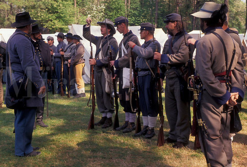 AJ3382, Confederate soldiers, Civil War Reenactment, Confederate, Stone Mountain, Atlanta, Georgia's Stone Mountain Park, Georgia, Men dressed as Confederate Soldiers prepare muskets (rifles) for firing during a Civil War Reenactment at the Antebellum Jubilee at Stone Mountain Park in Atlanta in the state of Georgia.