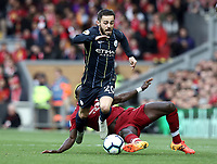 Manchester City's Bernardo Silva is fouled by Liverpool's Sadio Mane<br /> <br /> Photographer Rich Linley/CameraSport<br /> <br /> The Premier League - Liverpool v Manchester City - Sunday 7th October 2018 - Anfield - Liverpool<br /> <br /> World Copyright &copy; 2018 CameraSport. All rights reserved. 43 Linden Ave. Countesthorpe. Leicester. England. LE8 5PG - Tel: +44 (0) 116 277 4147 - admin@camerasport.com - www.camerasport.com