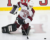 Merrick Madsen (Harvard - 31) - The Harvard University Crimson tied the visiting Dartmouth College Big Green 3-3 in both team's first game of the season on Saturday, November 1, 2014, at Bright-Landry Hockey Center in Cambridge, Massachusets.
