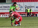 Scarlets flanker Aaron Shingler tackles Munster lock Billy Holland.<br /> Guiness Pro12<br /> Scarlets v Munster<br /> 21.02.15<br /> ©Steve Pope -SPORTINGWALES